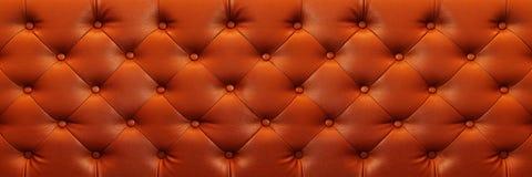 与按钮的水平的典雅的棕色皮革纹理backgr的 图库摄影