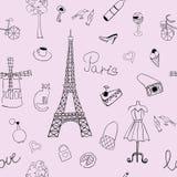 与描述法国的艾菲尔铁塔和其他项目的图象的无缝的纹理 库存照片