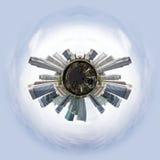 与摩天大楼的微小的行星 图库摄影