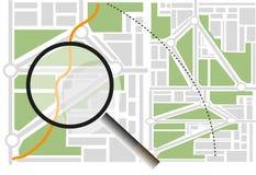 与放大镜的城市地图 免版税库存照片