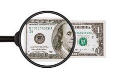 $ 1与放大镜的结束检查成为$ 100 免版税库存图片