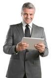 与数字式片剂的生意人 库存照片