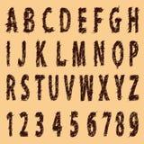 与数字的减速火箭的老难看的东西字母表。 图库摄影