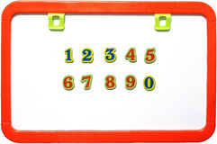 与数字的磁性whiteboard,被隔绝 免版税图库摄影