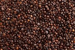 与整个五谷的美好的背景调味了咖啡 免版税图库摄影