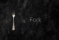 与文本叉子的老农庄叉子在具体顶视图 免版税库存图片