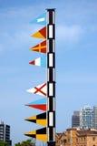 与文本口岸Vell -巴塞罗那西班牙的船舶旗子 库存照片