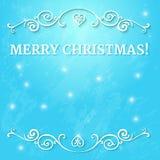 与文本圣诞快乐的花梢华丽框架在与落的雪和发光的光的蓝色背景 库存照片