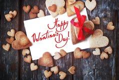 与文本愉快的情人节和曲奇饼的贺卡 免版税库存照片