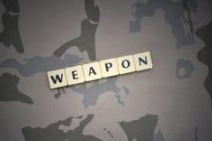 与文本武器的信件在卡其色的背景 装甲攻击机体关闭概念标志绿色m4a1军用步枪s射击了数据条工作室作战u 图库摄影