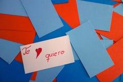 与文本的卡片我爱你用西班牙语 库存图片