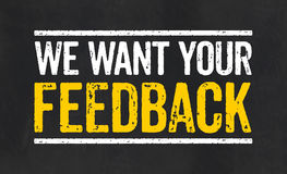 与文本的标志我们想要您的反馈 免版税库存照片