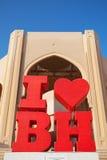 与文本的红色旅游标签我爱巴林 免版税库存照片