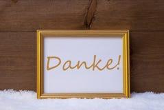 与文本Danke手段的框架感谢您雪的 免版税库存图片