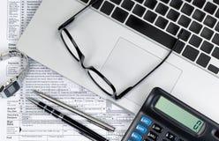 与文件和技术的税务计划时间 免版税库存照片