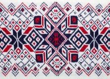 与斯堪的纳维亚装饰品的被编织的织品 免版税库存照片