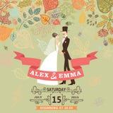 与新娘,新郎,秋天的逗人喜爱的婚礼邀请 库存照片