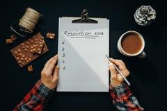 与新年决议题字的空白的册页纸与woma 图库摄影
