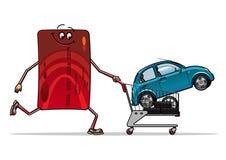 与新的汽车的信用卡在台车 免版税库存照片