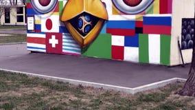 与旗子和动画片的街道画 股票录像