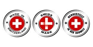 与旗子的圆的标签`瑞士制造`,与手表象的`瑞士做的` 免版税库存图片