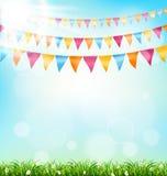 与旗布草和阳光的庆祝背景在天空 图库摄影