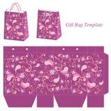 与无缝的样式的紫色礼物袋子模板 免版税图库摄影
