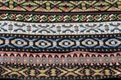 与无言颜色的当地美洲印第安人头饰带织品纹理 免版税库存照片