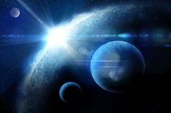 与日出的行星在星形背景  免版税库存图片