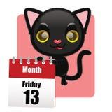 与日历的逗人喜爱的黑小猫 免版税库存照片