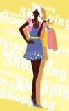 与时尚女孩和购物袋的背景 库存照片