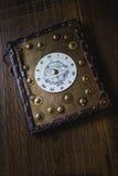 与时钟的书 免版税库存图片