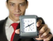 与时钟的商人 免版税库存图片