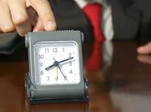 与时钟的商人 免版税图库摄影