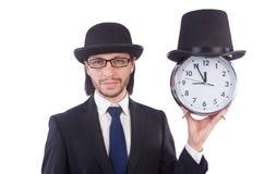 与时钟的商人 图库摄影