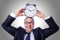 与时钟的生意人 图库摄影