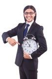与时钟的年轻商人 免版税库存图片