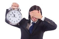 与时钟的年轻商人 免版税库存照片