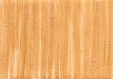 与明亮的发光的金子纹理的自然金黄背景 图库摄影
