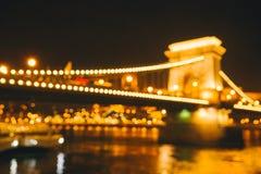 与明亮的城市光的被弄脏的背景 库存图片