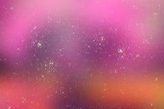 与明亮的星的满天星斗的桃红色宇宙背景 免版税图库摄影