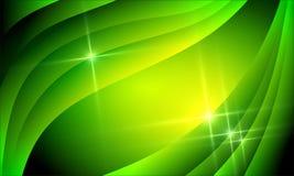 与明亮的梯度和迷离作用的金黄绿色背景 免版税库存照片