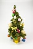与明亮的玩具的圣诞树在白色背景 库存图片