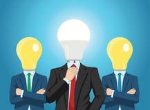 与明亮的电灯泡的专业企业队朝向 库存图片