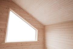 与明亮的窗口的角落在木墙壁 库存图片