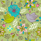 与明亮的花卉元素和鸟的无缝的五颜六色的纹理 免版税库存照片