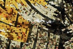 与明亮的衣服饰物之小金属片的织品 库存照片