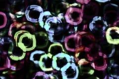 与明亮的colore圈子的抽象背景 库存照片