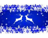 与星、雪花和闪烁的驯鹿 库存照片