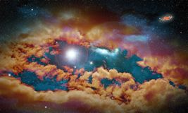 与星和星云的虚构的空间风景与火光在 免版税库存照片